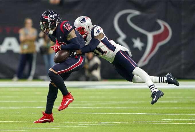 New England Patriots cornerback Jonathan Jones (31) breaks up a pass intended for Houston Texans wide receiver Kenny Stills (12) during the second half of an NFL football game Sunday, Dec. 1, 2019, in Houston. (AP Photo/David J. Phillip)