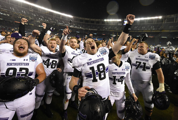Northwestern quarterback Clayton Thorson (18), and teammates celebrate after defeating Utah in the Holiday Bowl NCAA college football game Monday, Dec. 31, 2018, in San Diego. (AP Photo/Denis Poroy)