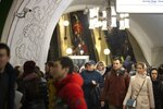 In this photo taken on Saturday, Feb. 22, 2020, a surveillance camera, top left, is seen as people walk down in a Moscow's Metro (subway) station in Moscow, Russia. Metro workers were instructed to stop passengers from China and ask them to fill out a questionnaire about the purpose of their visit to Russia, address of residence, health condition and whether they underwent quarantine upon arrival. (AP Photo/Alexander Zemlianichenko)