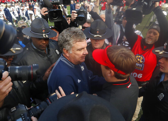 Georgia Tech head coach Paul Johnson, left, and Georgia head coach Kirby Smart meet at after an NCAA college football game, Saturday, Nov. 24, 2018, in Athens, Ga. Georgia won 45-21. (AP Photo/John Bazemore)