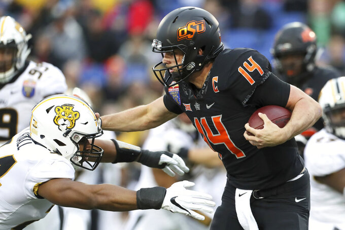 Oklahoma State tops No. 24 Missouri 38-33 in Liberty Bowl