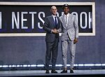 NBA Commissioner Adam Silver poses for photographs with Virginia Tech's Nickeil Alexander-Walker after the Brooklyn Nets selected him as the 17th pick overall in the NBA basketball draft Thursday, June 20, 2019, in New York. (AP Photo/Julio Cortez)