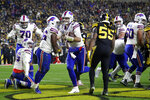 Buffalo Bills quarterback Josh Allen, center, scores on a 1-yard run during the first half of an NFL football game against the Pittsburgh Steelers in Pittsburgh, Sunday, Dec. 15, 2019. (AP Photo/Don Wright)