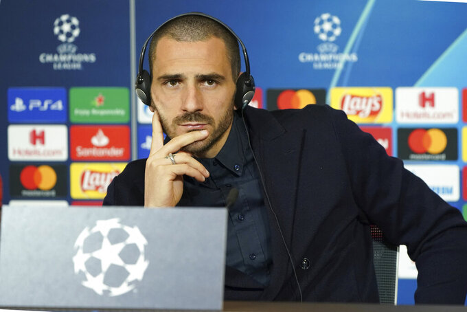 Juventus' Leonardo Bonucci answers to journalists during a press conference in Decines, near Lyon, central France, Tuesday, Feb. 25, 2020. Juventus will play against Lyon in a Champions League, round of 16th, first leg match on Wednesday,. (AP Photo/Laurent Cipriani)