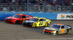 Justin Allgaier (7), Austin Cindric (22) and Noah Gragson (9) compete for the lead through Turn 4 on the final lap of a NASCAR Xfinity Series auto race at Phoenix Raceway, Saturday, Nov. 7, 2020, in Avondale, Ariz. (AP Photo/Ralph Freso)