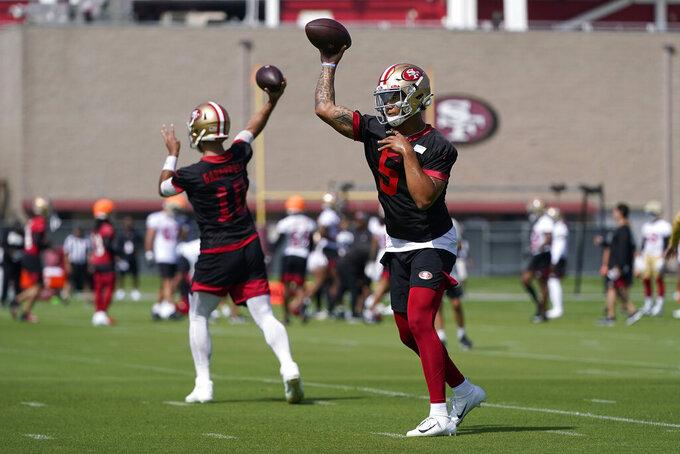 San Francisco 49ers quarterbacks Trey Lance (5) and Jimmy Garoppolo (10) throw passes at NFL football training camp in Santa Clara, Calif., Wednesday, July 28, 2021. (AP Photo/Jeff Chiu)