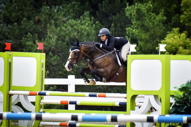 In this undated photo provided by Karie Alderman, Lauryn Gray competes during the Trillium Championships at Caledon Equestrian Park in Palgrave, Canada. One of the most candid conversations about race in sports is coming from a most unlikely of places: the show-jumping world. Gray, who has one black and one white parent, wrote a blog after she was inspired by fellow equestrian Sophie Gochman. (Karie Alderman via AP)
