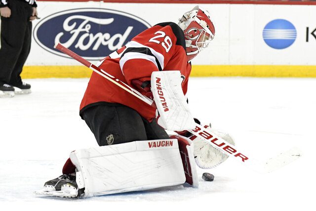 New Jersey Devils goaltender Mackenzie Blackwood (29) stops the puck during the first period of an NHL hockey game against the Los Angeles Kings, Saturday, Feb. 8, 2020, in Newark, N.J. (AP Photo/Bill Kostroun)