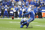 Indianapolis Colts kicker Adam Vinatieri (4) kicks the game winning field goal out of the hold of Rigoberto Sanchez (8) during the second half of an NFL football game against the Denver Broncos, Sunday, Oct. 27, 2019, in Indianapolis. Indianapolis won 15-13. (AP Photo/Michael Conroy)