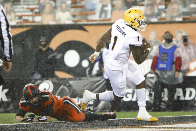 Arizona State running back Chip Trayanum (1) evades Oregon State inside linebacker Jack Colletto (12) to score a touchdown during the first half of an NCAA college football game in Corvallis, Ore., Saturday, Dec. 19, 2020. (AP Photo/Amanda Loman)