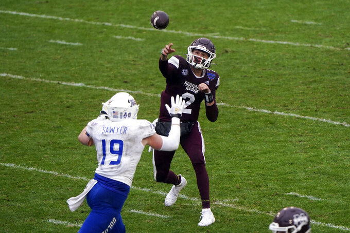Mississippi State quarterback Will Rogers (2) throws under pressure by Tulsa linebacker Grant Sawyer (19) during the second half of the Armed Forces Bowl NCAA college football game Thursday, Dec. 31, 2020, in Fort Worth, Texas. (AP Photo/Jim Cowsert)