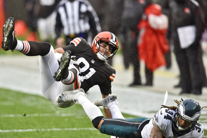 Cleveland Browns tight end Austin Hooper (81) is tackled during the first half of an NFL football game against the Philadelphia Eagles, Sunday, Nov. 22, 2020, in Cleveland. (AP Photo/David Richard)