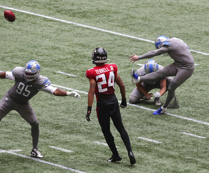 Detroit Lions kicker Matt Prater, right, makes the extra point-attempt to defeat the Atlanta Falcons with Falcons cornerback A.J. Terrell looking on as time expires in an NFL football game Sunday, Oct. 25, 2020, in Atlanta. (Curtis Compton/Atlanta Journal-Constitution via AP)