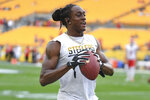 FILE - In this Aug. 17, 2019, file photo, Pittsburgh Steelers strong safety Terrell Edmunds (34) warms up before a preseason NFL football game, in Pittsburgh. Ferrell and Felicia Edmunds can't lose. Nor can they be prouder when the Pittsburgh Steelers host the Buffalo Bills on Sunday night, Dec. 15. It's a game that will feature all three of the Edmunds' sons _ the Steelers' Terrell and Trey Edmunds and the Bills' Tremaine _ facing off against each other. (AP Photo/Don Wright, File)