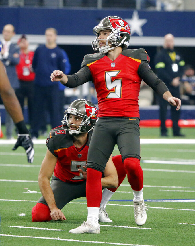 FILE - In this Dec. 23, 2018, file photo, then-Tampa Bay Buccaneers kicker Cairo Santos (5) and holder Bryan Anger (9) watches Santos missed field goal against the Dallas Cowboys during the second half of an NFL football game in Arlington, Texas. The Tennessee Titans have placed kicker Ryan Succop on injured reserve and have added veteran Cairo Santos to take over for him. Succop hadn't missed a game in five seasons with the Titans but had been recovering from offseason knee surgery. (AP Photo/Michael Ainsworth, File)
