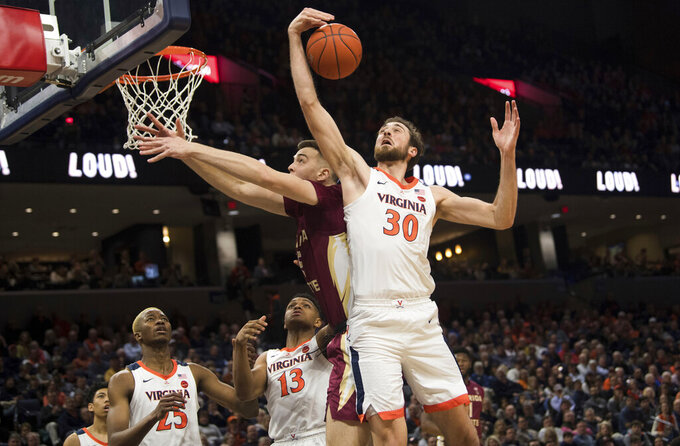 Virginia forward Jay Huff (3) pulls down a rebound next to Florida State's Balsa Koprivica during the first half of an NCAA college basketball game in Charlottesville, Va., Tuesday, Jan. 28, 2020. (AP Photo/Lee Luther Jr.)