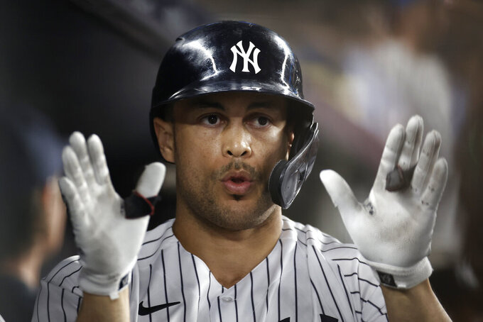 New York Yankees' Giancarlo Stanton celebrates a solo home run during the seventh inning of the team's baseball game against the Philadelphia Phillies on Tuesday, July 20, 2021, in New York. (AP Photo/Adam Hunger)