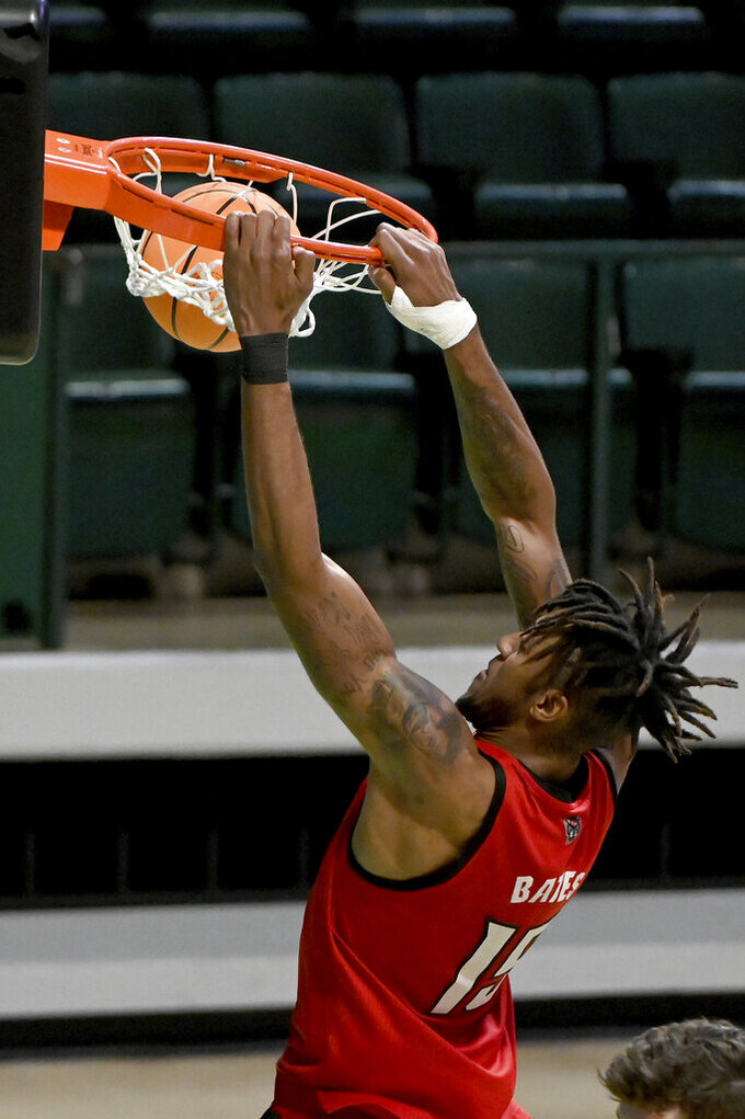 North Carolina State forward Manny Bates (15) dunks in the second half of an NCAA college basketball game against Davidson in the first round of the NIT, Thursday, March 18, 2021, in Denton, Texas. North Carolina State won 75-61. (AP Photo/Matt Strasen)