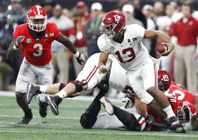 FILE - In this Jan. 8, 2018, file phot, Alabama quarterback Tua Tagovailoa runs during the second half of the NCAA college football playoff championship game against Georgia in Atlanta. Neither No. 1 Alabama nor No. 4 Georgia is anxiously awaiting their playoff fates this season, but whoever wins the SEC championship game showdown is definitely in the playoffs. The Crimson Tide could even get in with a close loss. (AP Photo/David Goldman, File)