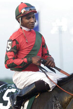 FILE - Jockey Marlon St. Julien sits aboard Four On The Floor after winning the Grand Prairie Turf Challenge at Lone Star Park in Grand Prairie, Texas, in this Monday, July 3, 2000, file photo. Black riders were atop 13 of the 15 horses in the first Kentucky Derby in 1875 and won 15 of the first 28 incarnations of the race. Kendrick Carmouche, on Saturday, May 1, 2021, will be the first Black Jockey in the Kentucky Derby since 2013 and just the fourth in the past century. (Jeffery Washington/Star-Telegram via AP, File)