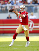 San Francisco 49ers quarterback Nick Mullens throws a pass against the Dallas Cowboys during the first half of an NFL preseason football game in Santa Clara, Calif., Saturday, Aug. 10, 2019. (AP Photo/John Hefti)