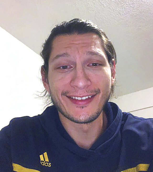In this photo provided by his attorney, Gaven Picciano, 26, of the Keweenaw Indian Community in Michigan, poses for a self-portrait on Friday, Nov. 13, 2020. Picciano is suing the Clark County Jail in Washington state as well as its medical provider, saying he lost about 35 pounds and was malnourished to the point of unconsciousness during a three-week stay early this year because staff failed to provide him gluten-free food to accommodate his celiac disease. The county declined to comment on the case. The medical provider, NaphCare Inc., did not respond to a request for comment. (Gaven Picciano via AP)