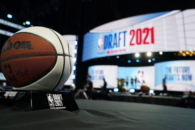 Stage crews prepare for the start of the NBA basketball draft, Thursday, July 29, 2021, in New York. (AP Photo/Corey Sipkin)