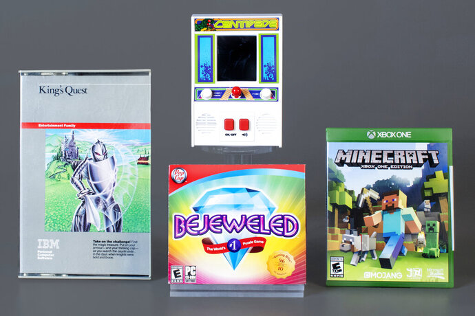 This photo provided the World Video Game Hall of Fame, Thursday, June 18, 2020, shows the organization's newest inductees. They are, clockwise from left are: King's Quest by Sierra On-Line; Centipede by Atari; Minecraft by Mojang Studios; and Bejeweled by PopCap Games. (World Video Game Hall of Fame via AP)