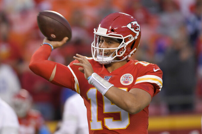 Kansas City Chiefs quarterback Patrick Mahomes warms up for the team's NFL football game against the Indianapolis Colts in Kansas City, Mo., Sunday, Oct. 6, 2019. (AP Photo/Reed Hoffmann)