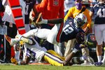 Auburn wide receiver Eli Stove (12) is tacked by LSU linebacker Micah Baskerville (23) as he reaches for the first down marker during the second quarter of an NCAA college football game Saturday, Oct. 31, 2020, in Auburn, Ala. (AP Photo/Butch Dill)
