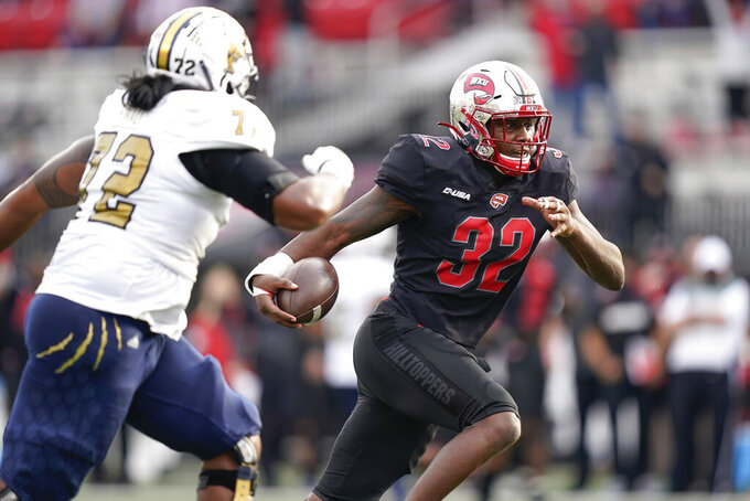 Western Kentucky linebacker Eli Brown (32) returns an interception for a touchdown against Florida International during the second half of an NCAA college football game Saturday, Nov. 21, 2020, in Bowling Green, Ky. (AP Photo/Bryan Woolston)