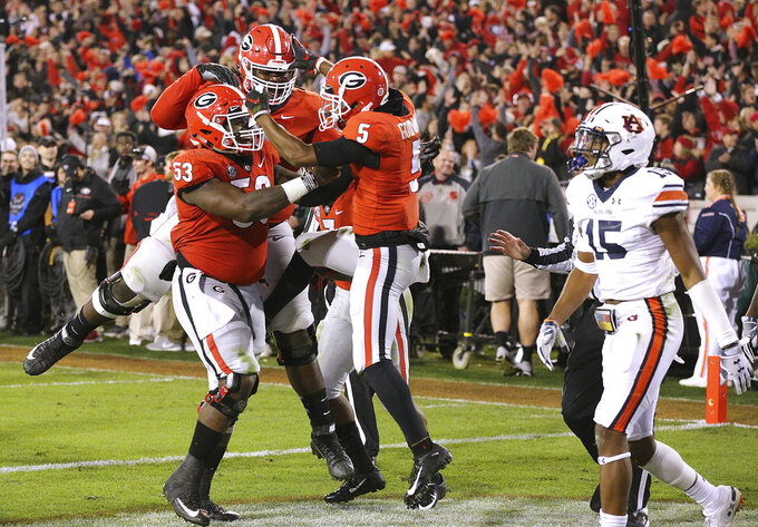 Georgia wide receiver Terry Godwin celebrates his 37-yard touchdown catch against Auburn during the second quarter of an NCAA college football game on Saturday, Nov. 10, 2018, in Athens, Ga. (Curtis Compton//Atlanta Journal-Constitution via AP)