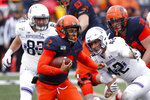 Illinois running back Reggie Corbin (2) carries the ball past Northwestern's Trent Goens (83) and Paddy Fisher during the first half of an NCAA college football game Saturday, Nov. 30, 2019, in Champaign , Ill. (AP Photo/Charles Rex Arbogast)
