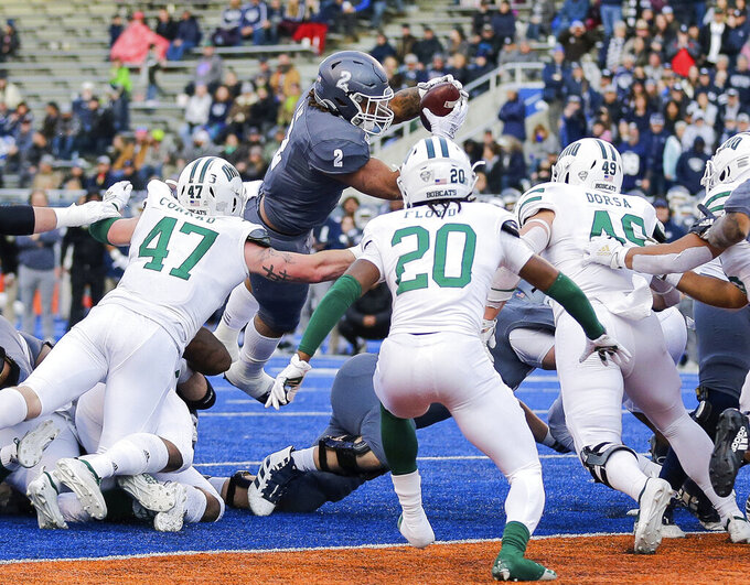 Nevada running back Devonte Lee (2) dives for the end zone during the second second half of the team's Famous Idaho Potato Bowl NCAA college football game against Ohio on Friday, Jan. 3, 2020, in Boise, Idaho. Lee was stopped short of the goal line. Ohio won 30-21. (AP Photo/Steve Conner)
