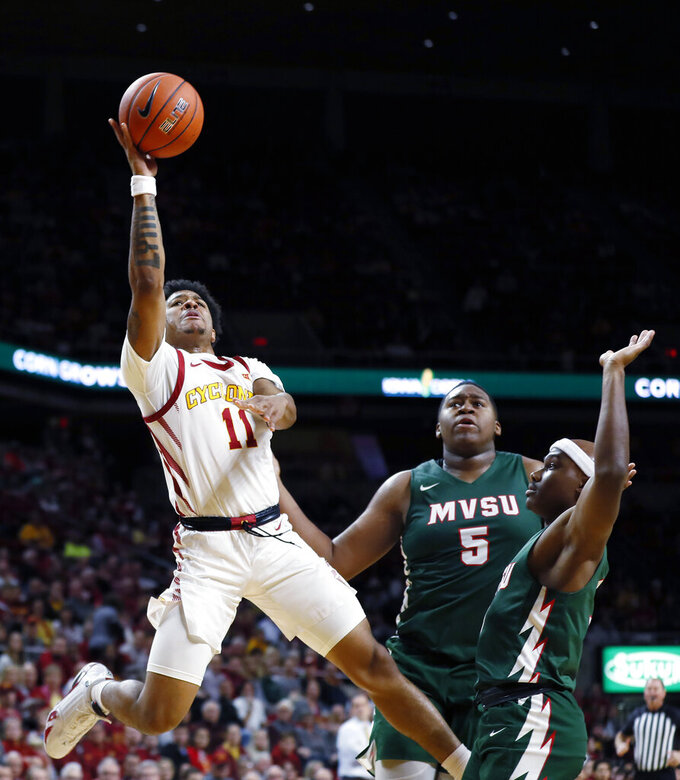Iowa State guard Prentiss Nixon, left, drives to the basket past Mississippi Valley State's Richard Rivers Jr. (5) and Caleb Hunter, right, during the first half of an NCAA college basketball game, Tuesday, Nov. 5, 2019, in Ames, Iowa. (AP Photo/Charlie Neibergall)