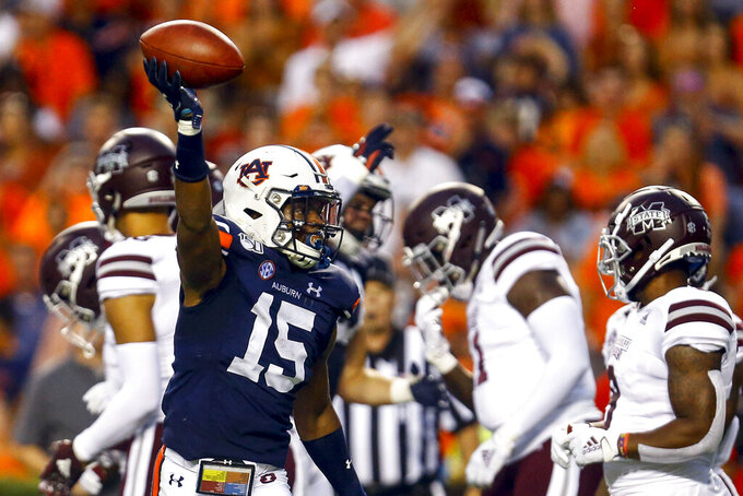 Auburn defensive back Jordyn Peters (15) celebrates after recovering a fumble during the first half of an NCAA college football game against Mississippi State, Saturday, Sept. 28, 2019, in Auburn, Ala. (AP Photo/Butch Dill)