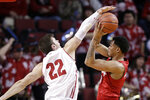 Nebraska's James Palmer Jr., right, tries to shoot as Wisconsin's Ethan Happ (22) defends during the first half of an NCAA college basketball game in Lincoln, Neb., Tuesday, Jan. 29, 2019. (AP Photo/Nati Harnik)