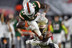 Miami running back Cam'Ron Harris loses the ball out of bounds while trying to jump over Florida State defensive back Travis Jay during the first half of an NCAA college football game Saturday, Sept. 26, 2020, in Miami Gardens, Fla. (Michael Laughlin/South Florida Sun-Sentinel via AP)