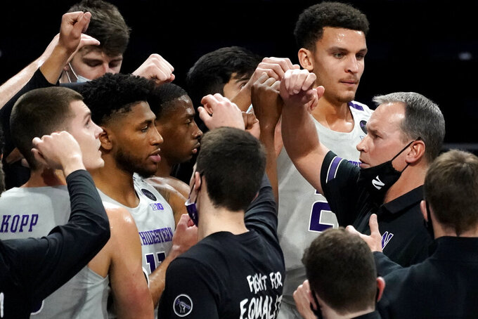 Northwestern head coach Chris Collins, right, cheers on his team during the first half of an NCAA college basketball game against Pittsburgh in Evanston, Ill., Wednesday, Dec. 9, 2020. (AP Photo/Nam Y. Huh)