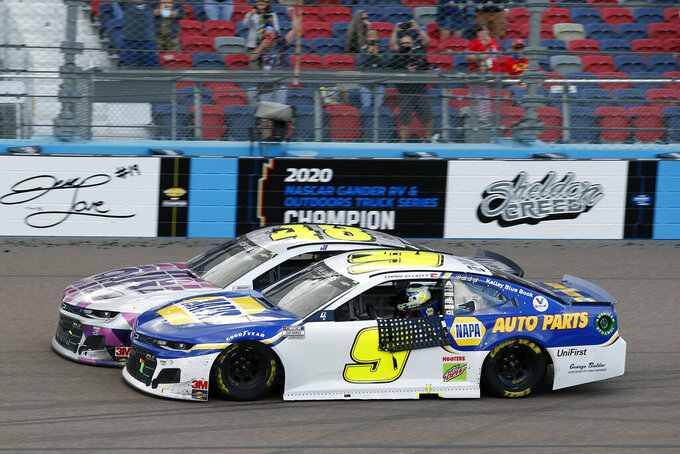 Jimmie Johnson (48) pulls up next to Chase Elliott (9) in Turn 4 following Elliott's season championship victory in the NASCAR Cup Series auto race at Phoenix Raceway, Sunday, Nov. 8, 2020, in Avondale, Ariz. (AP Photo/Ralph Freso)