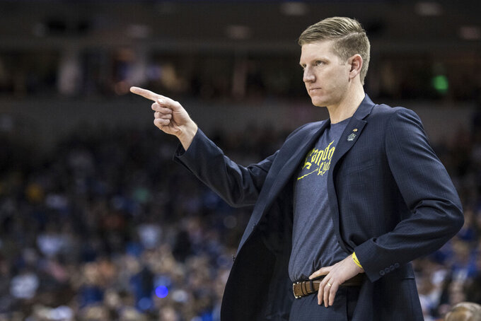 North Dakota State coach David Richman communicates with a player during the first half against Duke in a first-round game in the NCAA men's college basketball tournament Friday, March 22, 2019, in Columbia, S.C. (AP Photo/Sean Rayford)