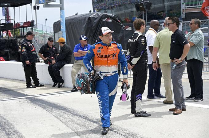 Driver Ryan Vargas walks to his vehicle on pit road before a NASCAR Xfinity Series auto race at Daytona International Speedway, Saturday, Aug. 28, 2021, in Daytona Beach, Fla. (AP Photo/Phelan M. Ebenhack)