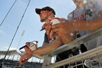 Autograph seekers wait for players before a spring training baseball game between the Boston Red Sox and the Houston Astros, Thursday, March 5, 2020, in Fort Myers, Fla. (AP Photo/Elise Amendola)