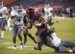 San Diego State running back Juwan Washington (29) is tackled by Nevada linebacker Gabriel Sewell (7) on a run during the first half of a college football game Saturday, Nov. 9, 2019, in San Diego. CA. (AP Photo/Denis Poroy)