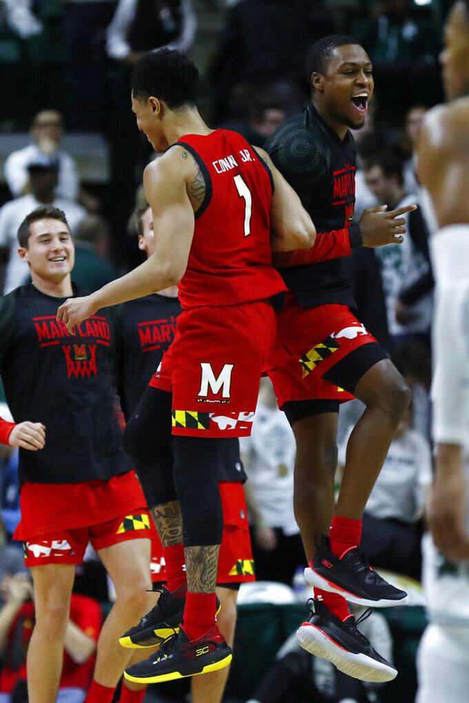 Maryland guard Anthony Cowan Jr. (1) celebrates with Travis Valmon in the second half of an NCAA college basketball game in East Lansing, Mich., Saturday, Feb. 15, 2020. Maryland beat Michigan State 67-60. (AP Photo/Paul Sancya)