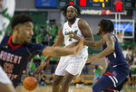 Marshall's Iran Bennett (2) works the post against Robert Morris' D.J. Russell, right, during an NCAA college basketball game Thursday, Nov. 7, 2019, in Huntington, W.Va. (Sholten Singer/The Herald-Dispatch via AP)