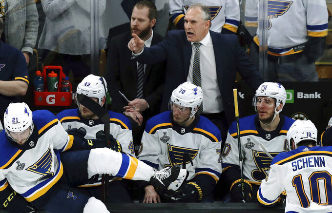 St. Louis Blues head coach Craig Berube gives instructions from behind the bench during the third period in Game 2 of the NHL hockey Stanley Cup Final against the Boston Bruins, Wednesday, May 29, 2019, in Boston. (AP Photo/Charles Krupa)
