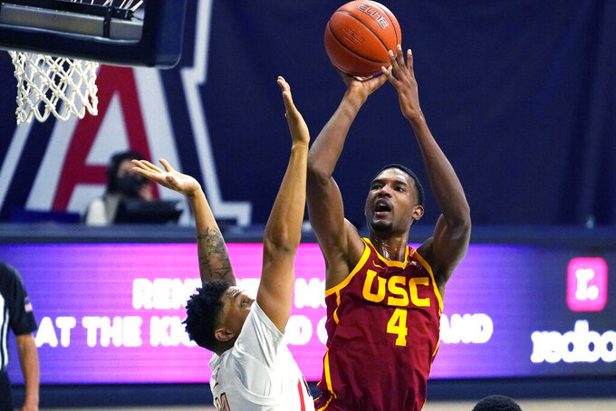 Southern California forward Evan Mobley (4) shoots over Arizona forward Ira Lee during the first half of an NCAA college basketball game Thursday, Jan. 7, 2021, in Tucson, Ariz. (AP Photo/Rick Scuteri)