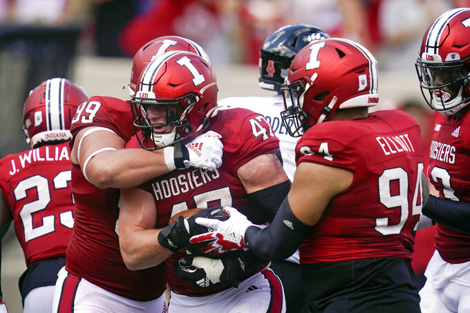 Indiana's Micah McFadden (47) celebrates with Weston Kramer (99) and Demarcus Elliott (94) after McFadden recovered a fumble after during the first half of an NCAA college football game against Cincinnati, Saturday, Sept. 18, 2021, in Bloomington, Ind. (AP Photo/Darron Cummings)