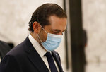 Lebanese Prime Minister-Designate Saad Hariri arrives at the Presidential Palace to meet with Lebanese President Michel Aoun, in Baabda, east of Beirut, Lebanon, Thursday, Oct, 22, 2020. Aoun asked former premier Hariri to form the country's next government Thursday after he secured enough votes from lawmakers - bringing back an old name to lead the country out of its dire political and economic crises. (AP Photo/Hussein Malla)